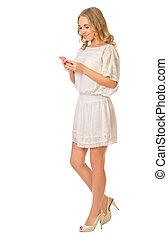 jovem, menina sorridente, com, telefone móvel