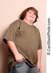jovem, menino adolescente, lateralmente, com, mão, em, calças brim