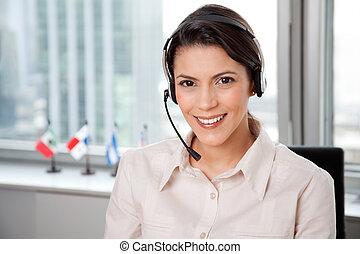 jovem, mulher negócio, com, headset
