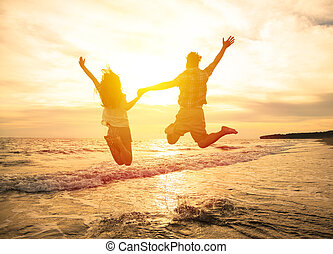jovem, par feliz, pular, ligado, praia