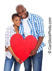 joven, africano, pareja, tenencia, forma corazón