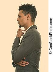 joven, africano, perfil, pensamiento, vista, hombre de negocios