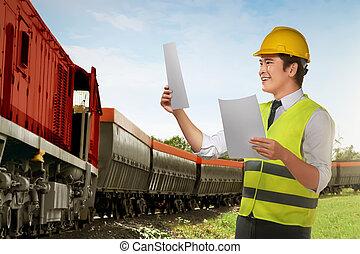 joven, asiático, trabajador, verificar, en, tren, máquina