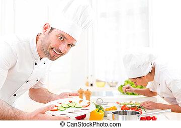 joven, atractivo, profesional, chef, cocina, en, el suyo, cocina