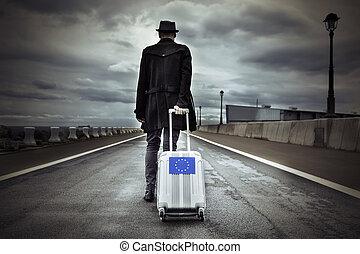 joven, bandera, maleta, rodante, hombre, europeo