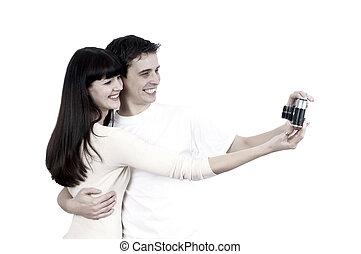 joven, belleza, pareja, con, cámara fotográfica de la foto, aislado, blanco, plano de fondo