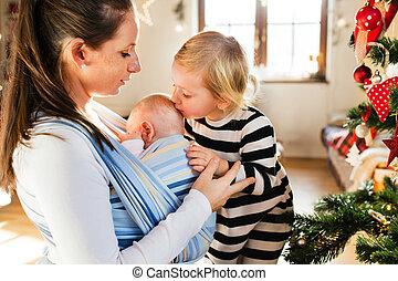 joven, dos, navidad, time., madre, niños