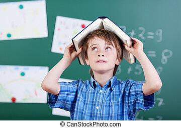 joven, elemental, colegial, con, un, libro, cabeza
