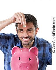 joven, feliz, hombre, tenencia, moneda, poniendo, él, en, banco guarro rosado