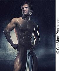 joven, guapo, atleta, el estar parado en la lluvia