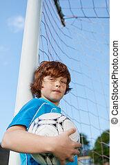 joven, jugador del fútbol