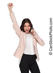 joven, mujer de negocios, celebra, éxito, en, mientras, hablar teléfono