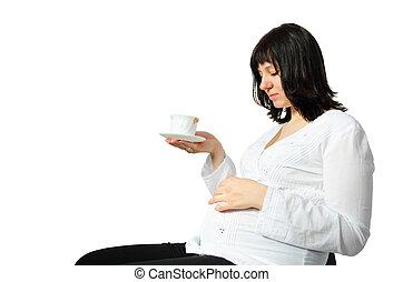 joven, mujer embarazada, bebidas, té, de, un, taza blanca