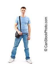 joven, posición, con, manos en bolsillos