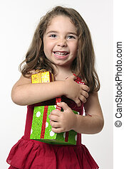 Jovial happy girl child holding presents
