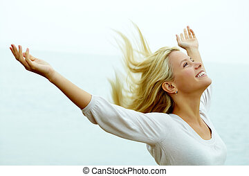 Joy and freedom - Portrait of happy young girl with ...