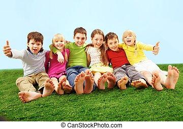 Joy - Cheerful children having fun on grass