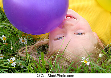 Joy - Little girl playing with balloons