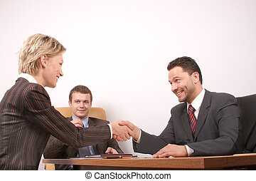 Negotiation over, contract signed, man and woman handshake - joy