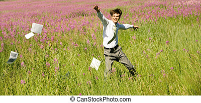Joy - Photo of happy businessman running upon green field on...