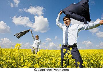 Joy - Portrait of happy business partners happily screaming...