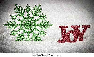 Joy and a green star with a snow background