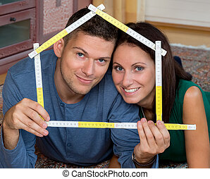 joy to the new house - a young couple is looking forward to...