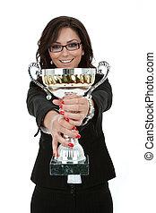 joyfu female entrepreneur holding a trophy