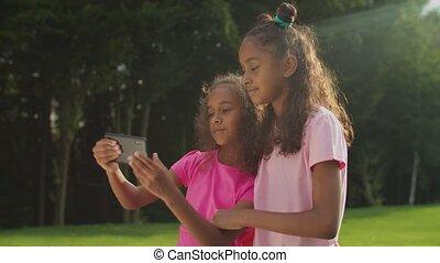 Joyful african little sisters making selfie shot - Two ...