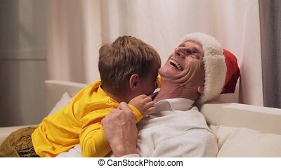 Joyful aged man resting with his grandson at home - Happy...