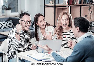Joyful amazed colleagues having fun and communicating. - We...