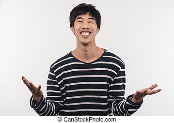 Joyful Asian man expressing his emotions