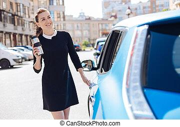 Joyful attractive businesswoman smiling