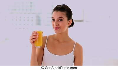 Joyful beautiful woman enjoying juice