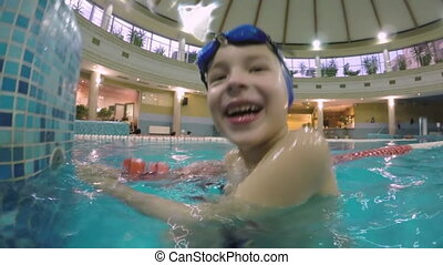 Joyful boy in the swimming pool