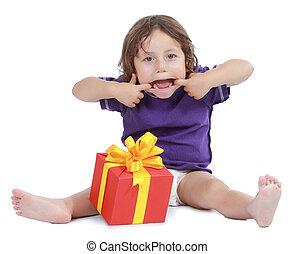 Joyful boy with present box