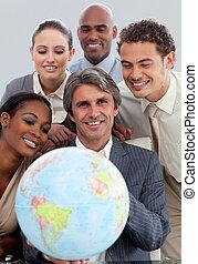 Joyful business group showing ethnic diversity holding a terretrial gobe