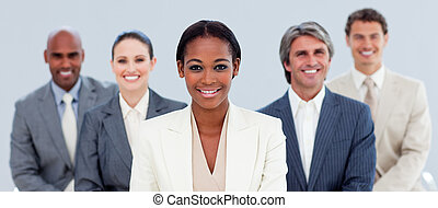 Joyful business team standing in the meeting room