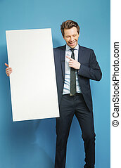Joyful businessman carrying the white board