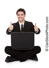 Joyful businessman rejoicing