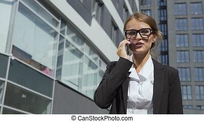 Joyful Businesswoman Talking on Phone