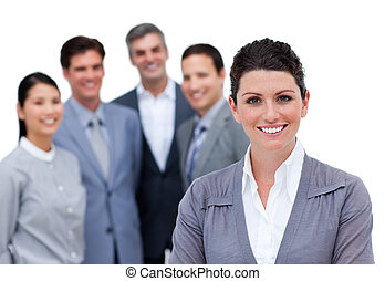 Joyful businesswoman with folded arms standing with his team