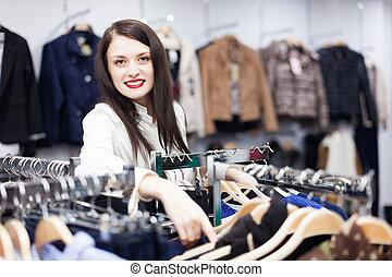 Joyful buyer at clothing store