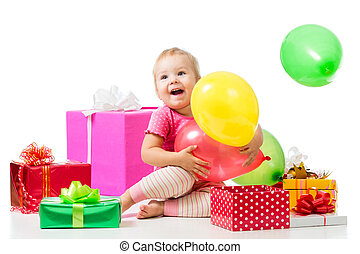 Joyful child girl with colorful balloons and gifts. Isolated on white.