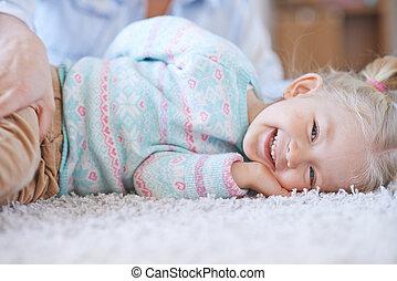 Joyful child - Joyful kid in casualwear lying on the floor