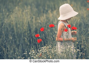 Joyful Childhood Scene. Joyful Child Between Poppy Flowers....