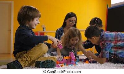 Joyful children enjoying leisure in kindergarten - Joyful...