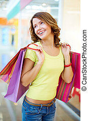 Joyful consumer - Vertical shot of a joyful consumer...