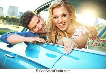 Joyful couple enjoying the fast ride