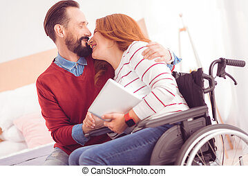 Joyful couple enjoying time at home